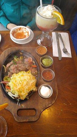 3 Amigos: Beef fajitas, condiments and a pina colada.