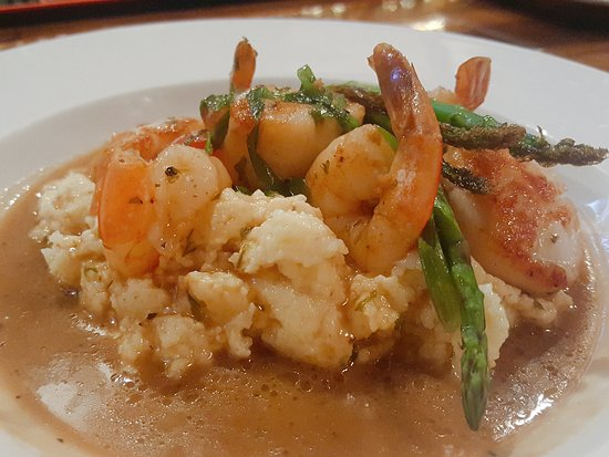 Cookeville, TN: shrimp and scallops, pan seared and over asparagus, grits with mushrooms, and corn ragout sauce.