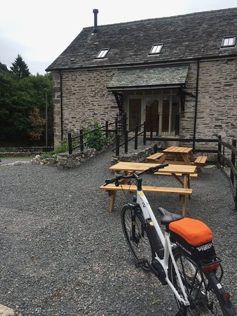 Entrance to Witherslack Cycle Barn, outdoor seating area, electric bike hire, 4 ensuite rooms fo