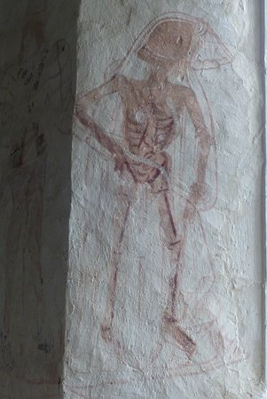 Llancarfan, UK: The ghoulish cadaver-like figure leading the way to the churchyard outside.