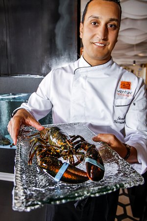 Samuel showcasing some of our fresh lobster