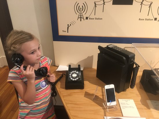 North Chatham, MA: Our daughter using the old telephone to call her dad.