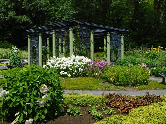 One of several gardens with a shaded area with seats and ...