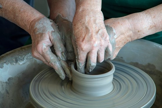 Redcar, UK: Hands-on tuition at the potter's wheel (ceramicist Susan Tindale).