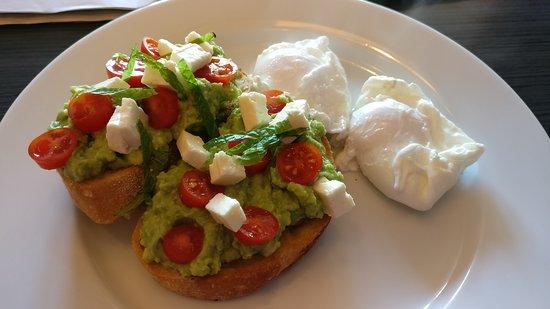 Como, Australia: Avocado smash on sourdough bread with a side of poached eggs.