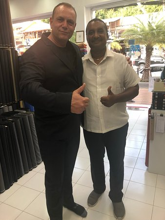 A very happy guest from Netherlands in his regular fit black suit at King's Fashion tailor, Aona