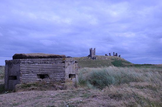 Craster, UK: Coastal defences - recent and historic.The view from Embleton links.