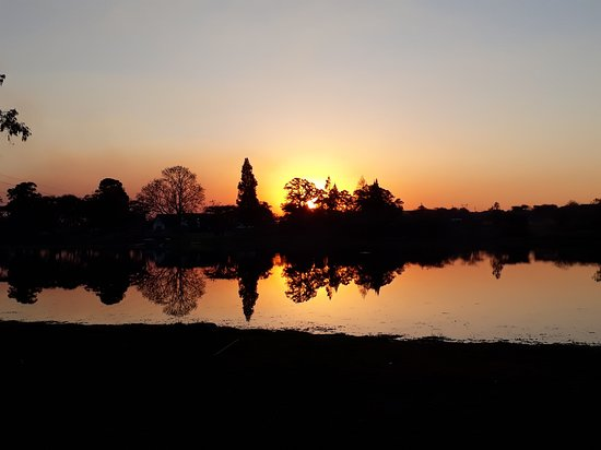 A beautiful sunset over a lake in Ruwa