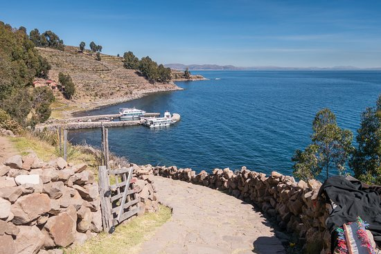 Taquile Island, Peru: At the gates to the restaurant, looking at the north port on Taquile