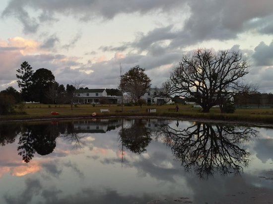 Redford House: View of Redford homestead from across the dam at dusk