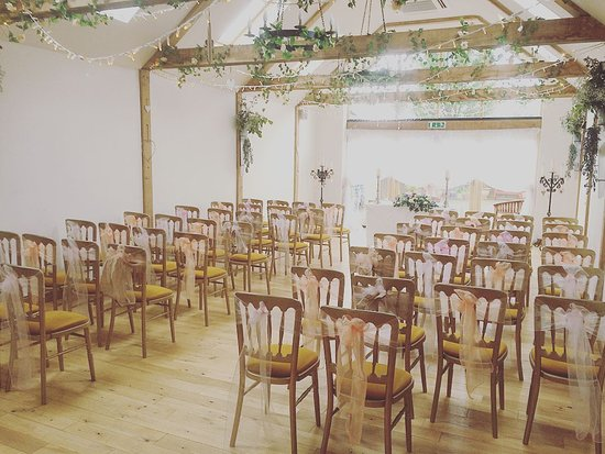 Slinfold, UK: Decorations by Allblewnup and Random Hall, i didn't want chair covers with such pretty wooden ch