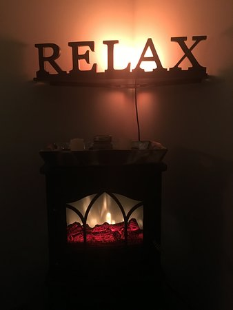 A RELAXing fireplace while receiving your massage! - Picture