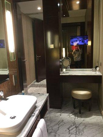 Open Bathroom Has Vanity Seat Sink Separate Tiolet Annd Shower