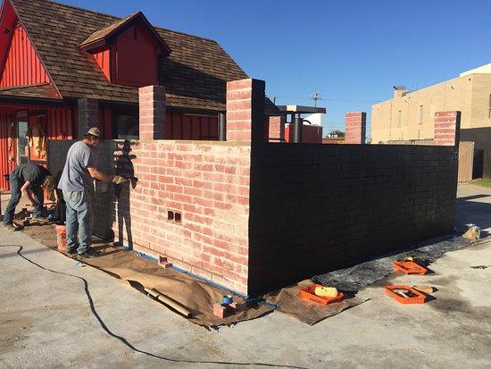 Watauga, TX: Painting The Bricks To Match The Building