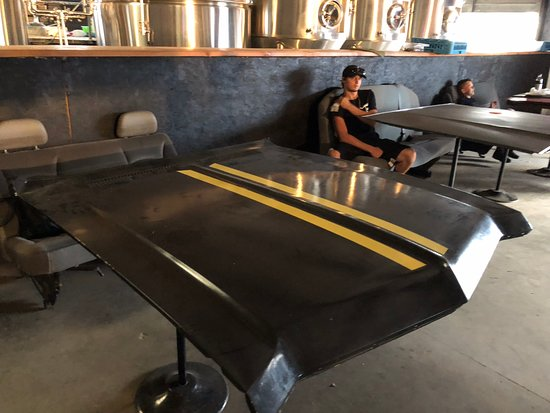 Grants, NM: Tables made from hoods of cars and bench seats out of old cars