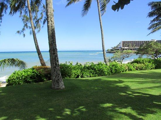 Beach Cottage Patio Hotel In Distance