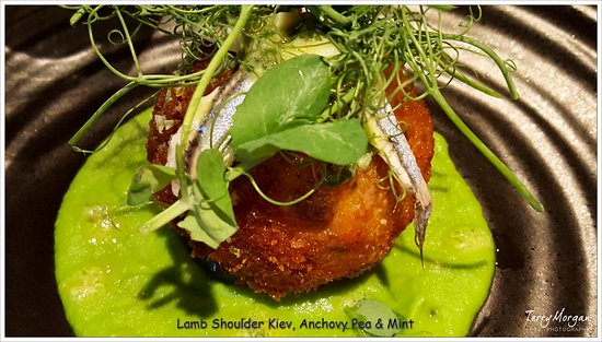Baslow, UK: Perfectly cooked lamb encassed in a crispy shell sitting in a fabulous bed of pea and mint