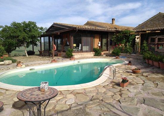 Castellana Sicula, Италия: Pool, terrace and dining room/ lounge