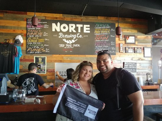 Norte Brewery couple Border tours Flag