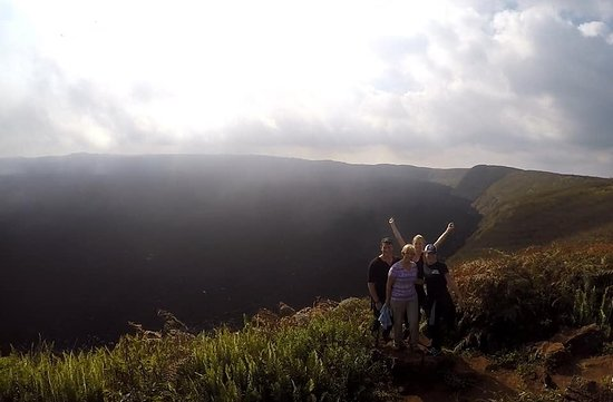 Isabela, Ecuador: Us at the crater of Sierra Negra above the rain clouds!