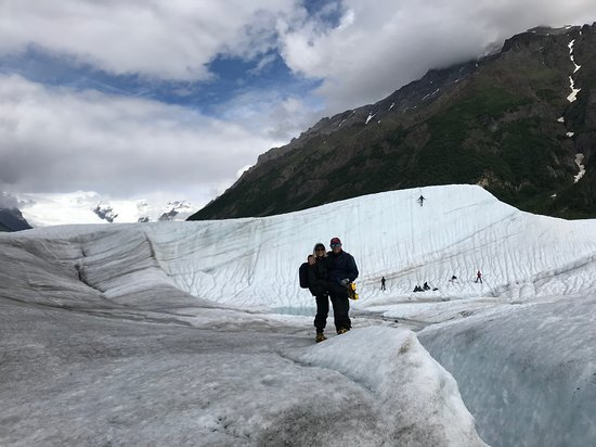 Kennicott, AK: Root Glacier hiking with Ice climbing in the background