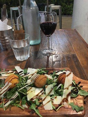 Varsity Lakes, Australia: arancini with rocket and shaved parmesan + Merlot