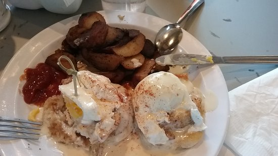 Highland Bakery: eggs benedict on biscuits with potatoes and gravy