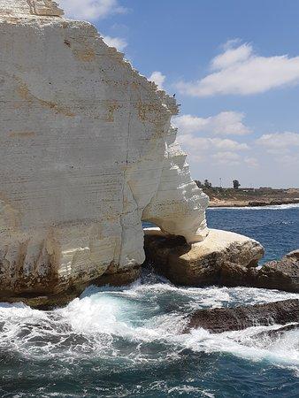 "Kefar Rosh HaNiqra, Israel: Rosh HaNigra grottoes -""Elephant leg"" carved in the limestone by the sea"