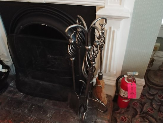 wood burning fireplace complete with adjacent fire extinguisher rh tripadvisor com
