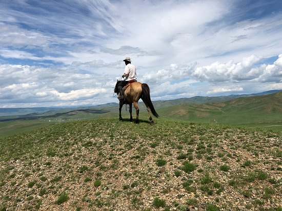 Tov Province, Mongolia: Baagii, Co-owner of Horse trek Mongolia summiting the hills surrounding our home camp.