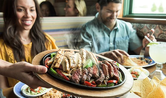 Miami Lakes, FL: Our famous fajitas are grilled over mesquite wood and served with warm flour tortillas, sour cre