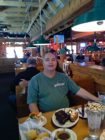 Taylorsville, Юта: At the Texas Roadhouse, sitting across the table from my husband