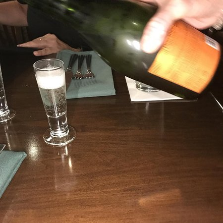 """Annie Gunn's: Everyone gets a """"Hello"""" shot of bubbly for dinner!"""