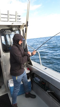 Jimmy cleaning fish - Picture of Manns Charter Service