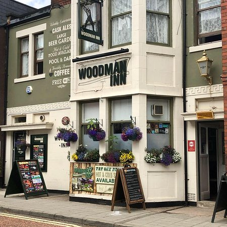 ‪The Woodman Inn‬