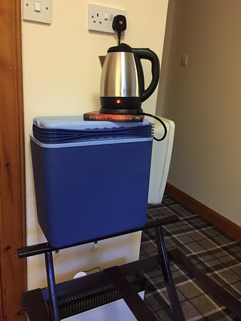 Muthu Royal Hotel: Kettle placed on various furniture and cool box just to plug in the kettle.