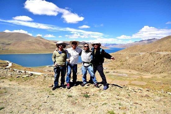 Tibet Travelers: White clouds slant across the blue sky