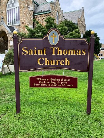 Road sign and mass times - Picture of St  Thomas Roman