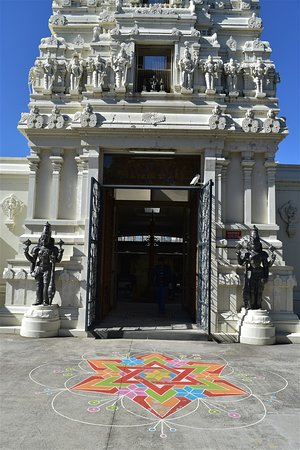 Sri Venkateswara Temple: The colourful floor pattern enhances the rear entrance