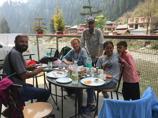 Taj River View Hotel & Restaurant: Enjoying eating the trout we caught!