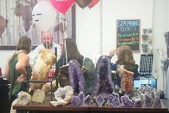Landrum, SC: Prices on wall - various rocks for sale and on display. Education at counter