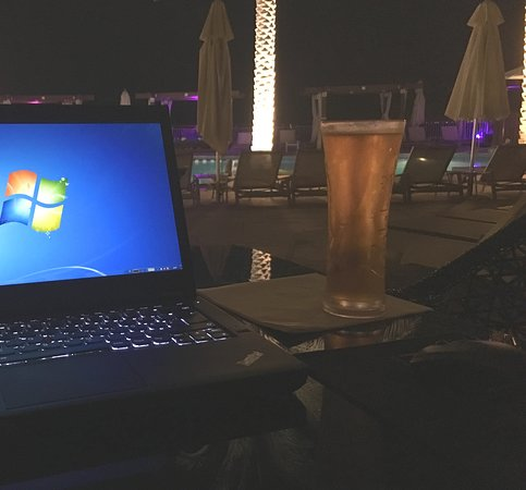 Enjoying the evening with a drink at pool side and connect