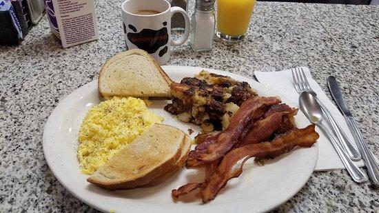 Maureen's Kitchen: Scrambled eggs, bacon, home fries, Rye toast, coffee, and OJ.