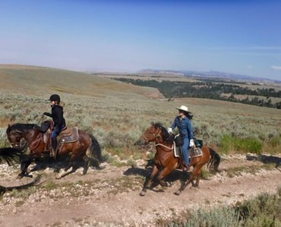 Shell, WY: Riding a well-trained mustang (adopted from WY wild herd)