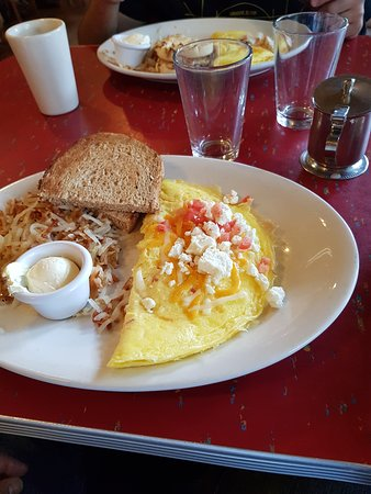 Le Peep: Omelette with cheddar,swiss and feta cheese, Hash browns and wheat toast.
