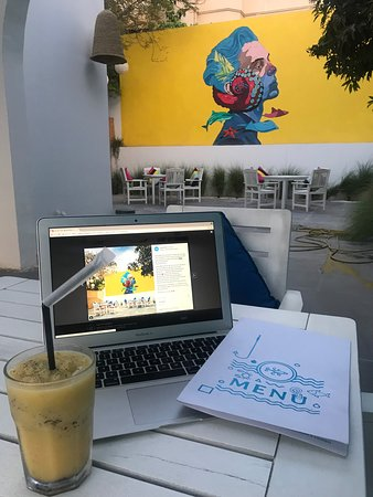 Garden vibes with artwork and fresh juice made with passion fruit and lemon