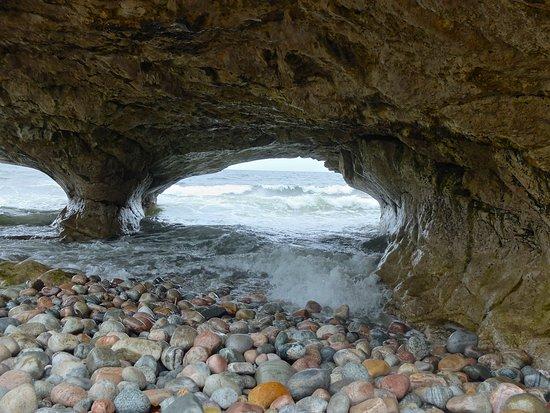 Portland Creek, Canada: Waves breaking through the arches