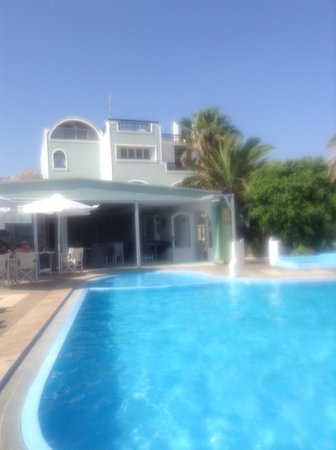 Nice pool with plenty of sun beds and parasols