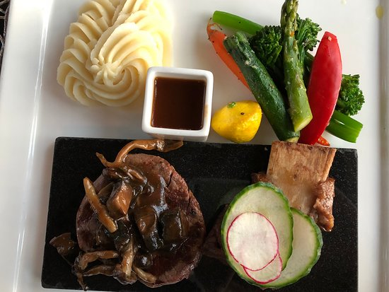 Priddis, Canada: Wagyu Beef Tenderloin with braised short rib, baby vegetables, au jus and truffle mashed potatoe