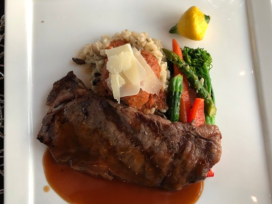 Priddis, Canada : Wagyu Striploin, slow braised meatball on mushroom risotto and baby vegetables.